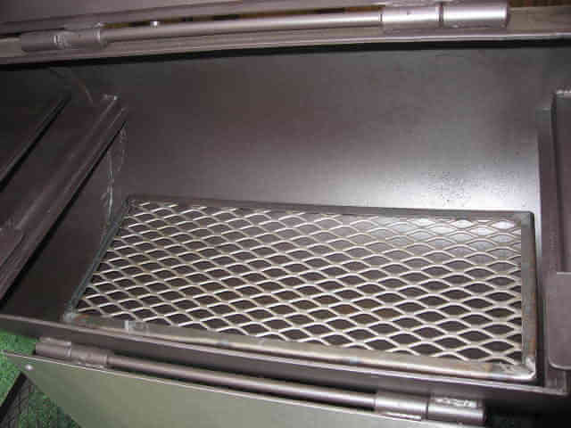 lift out grate at lower level of model 1628CC smoker pit