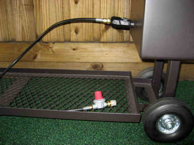 log lighter assembly installed in model 1628CC smoker pit