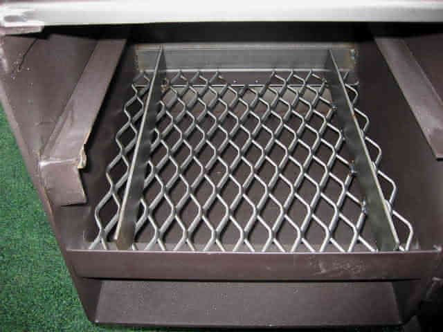wood rack in lowest position in model 1628CC smoker pit