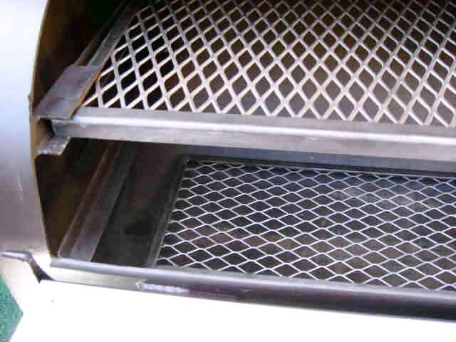 lower lift out cooking grates inside barrel of model 2040 smoker pit