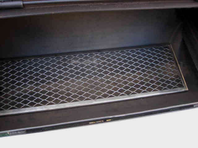 full view of lower lift out cooking grate in model 2040CC smoker pit