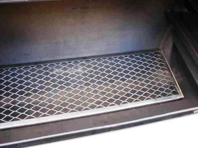 lower cooking grate inside of model 2040 smoker pit