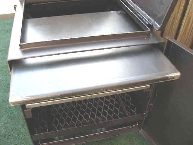 heat baffle and griddle will slide out firebox door of model 2442 smoker pit