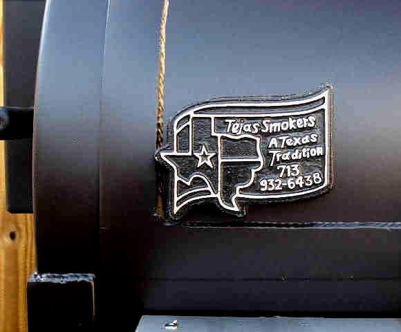 Tejas Smokers logo on front of the model 2442 smoker pit
