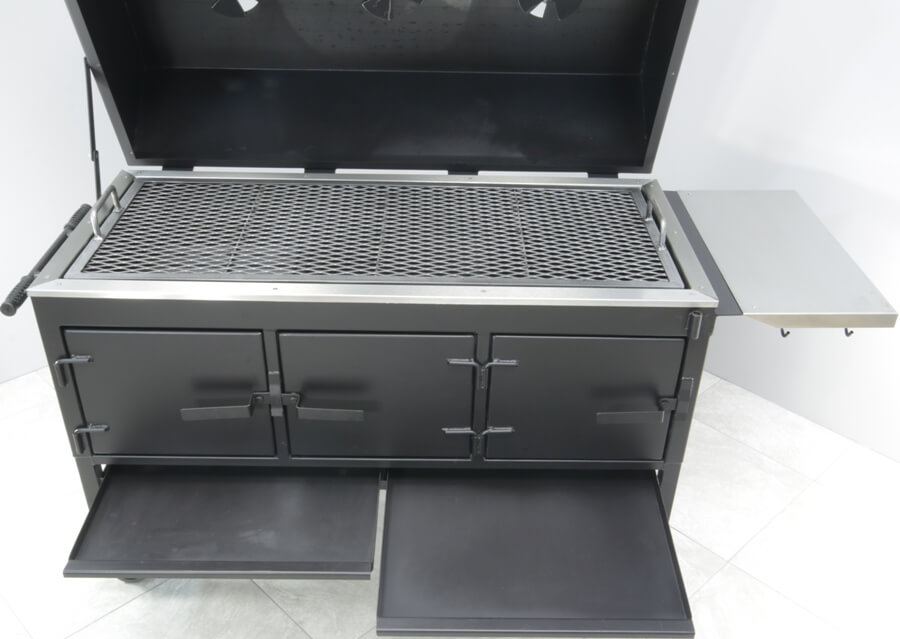 model 2454XL charcoal grill with two charcoal ash trays pulled out