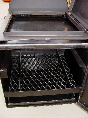wood rack installed at lowest position in firebox of model 2040CC smoker pit